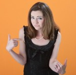 girl with arms outstretched asking a question