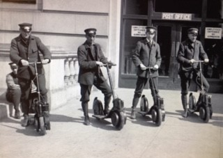 Post Office carriers on scooters 100 years ago